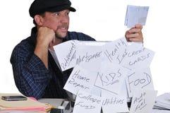 Anxious Man Looking At Bills. Royalty Free Stock Photo