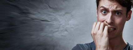 Anxious man. Anxious nervous man portrait over gray wall background Stock Photography