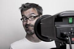 Anxious photographer looks into a studio strobe stock photo