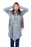 Anxious pretty brunette wearing winter clothes posing Royalty Free Stock Photo