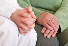 Anxious and relaxed hands. Clasped anxious young and elderly relaxed hands Royalty Free Stock Photos