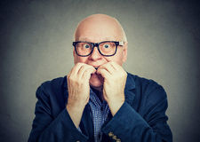 Anxious scared senior man biting fingernails Royalty Free Stock Photo
