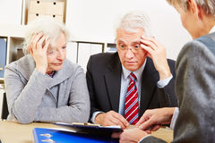 Anxious senior couple worring about Stock Image