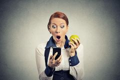 Anxious shocked business woman looking at phone seeing bad news. Closeup portrait anxious shocked young business woman looking at phone seeing bad news or photos royalty free stock photos