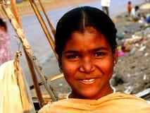 Anxious Smile. A poor Indian girl smiles anxiously royalty free stock photos