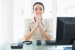 Anxious stylish brunette businesswoman praying Royalty Free Stock Photo