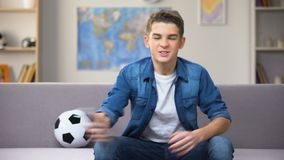 Anxious teenage boy watching football match on TV unhappy with team losing sport. Stock footage stock footage
