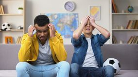 Anxious teenagers watching football match on TV unhappy with team losing, sport. Stock footage stock video