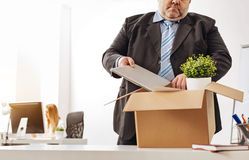 Anxious tired employee packing his things Royalty Free Stock Photo