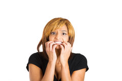 Anxious unhappy woman biting her nails in anticipation Royalty Free Stock Images