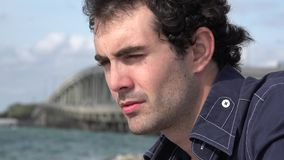 Anxious Urban Male Near Ocean. Stock video of anxious urban male stock video footage