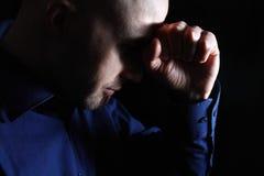 Male depression. Anxious white man low key portrait Stock Images