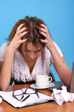 Anxious woman. In office with blue walls Stock Photo