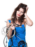 Anxious woman with computer cable Royalty Free Stock Photos