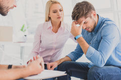 Anxious woman with man in desperation Royalty Free Stock Images