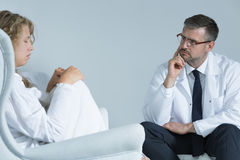 Anxious woman with a psychiatrist Stock Images