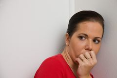 Anxious woman symbol of violence in the family royalty free stock photos
