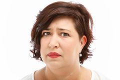 Anxious worried woman. Anxious worried middle-aged woman with upset expression isolated on white Royalty Free Stock Images