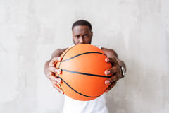 Anxious young athlete gazing and concentrating at basket-ball stock images