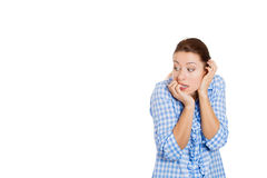 An anxious young attractive woman biting her nails Stock Photo