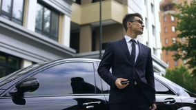 Anxious young businessman waiting for late partners, poor time management stock footage
