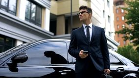 Anxious young businessman waiting for late partners, poor time management stock photos