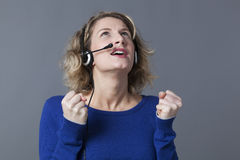 Anxious young female professional talking with a headset Stock Photo