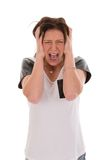 Anxious young woman yelling of fear royalty free stock photography