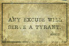 Any excuse Aesop. Any excuse will serve a tyrant - famous ancient Greek story teller Aesop quote printed on grunge vintage cardboard stock images
