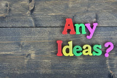 Any Ideas ? on wooden table Royalty Free Stock Photo