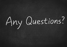 Any questions?. Concept text on blackboard background stock image