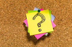 Any questions?. The question sign on the sticky paper note. Great for visualizing web pages, make presentations, banners and other needs. Clear and colorful Royalty Free Stock Photos