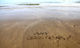 Any Questions writing on the beach sand Stock Photography