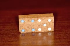 Wood dominoes and numbers stock photos
