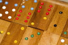 Wood dominoes and numbers stock photography