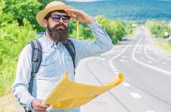 Any transport. Traveler with map looking for hitchhiking transportation alone at edge of road. Tips to get on road. Must. Know tricks hitchhiking across country stock images