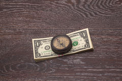 Any trip is expensive. Ancient compass on the background of banknotes tapered royalty free stock photos