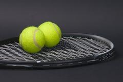 Anyone for tennis. Tennis racket and balls Stock Photos
