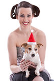 Anything for the boss. Cute adorable jack russel terrier with christmas hat (focus on dog Royalty Free Stock Images