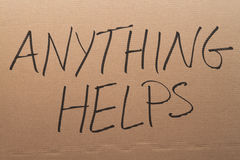 Anything Helps Cardboard Sign Stock Photo
