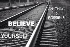 Anything is possible. Believe in yourself. Great quality work. On this picture you can see business and social concept motivational quotes on blurred background stock photo