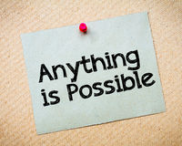 Anything is possible. Message. Recycled paper note pinned on cork board. Concept Image Stock Photo