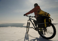Anywhere. Biker going on ice. Lake Baikal, Eastern Siberia Royalty Free Stock Photography