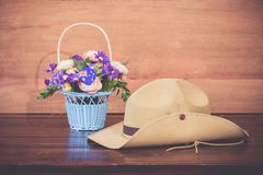 Anzac army slouch hat with Australian Flag. On vintage wood background Royalty Free Stock Image