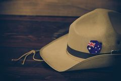 Anzac army slouch hat with Australian Flag. On vintage wood background Stock Images
