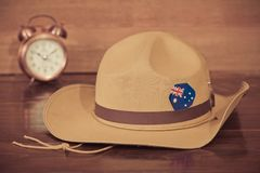 Anzac army slouch hat with Australian Flag. On vintage wood background Royalty Free Stock Images