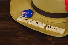 Anzac army slouch hat with Australian Flag. On vintage wood background Royalty Free Stock Photography