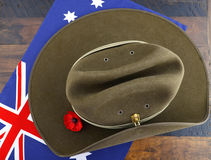 Anzac army slouch hat. With Australian Flag on vintage wood background Stock Photo