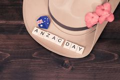 Anzac army slouch hat with Australian Flag. On vintage wood background Stock Photography