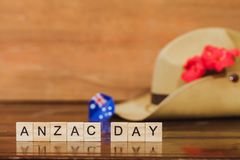 Anzac army slouch hat with Australian Flag. On vintage wood background Royalty Free Stock Photo